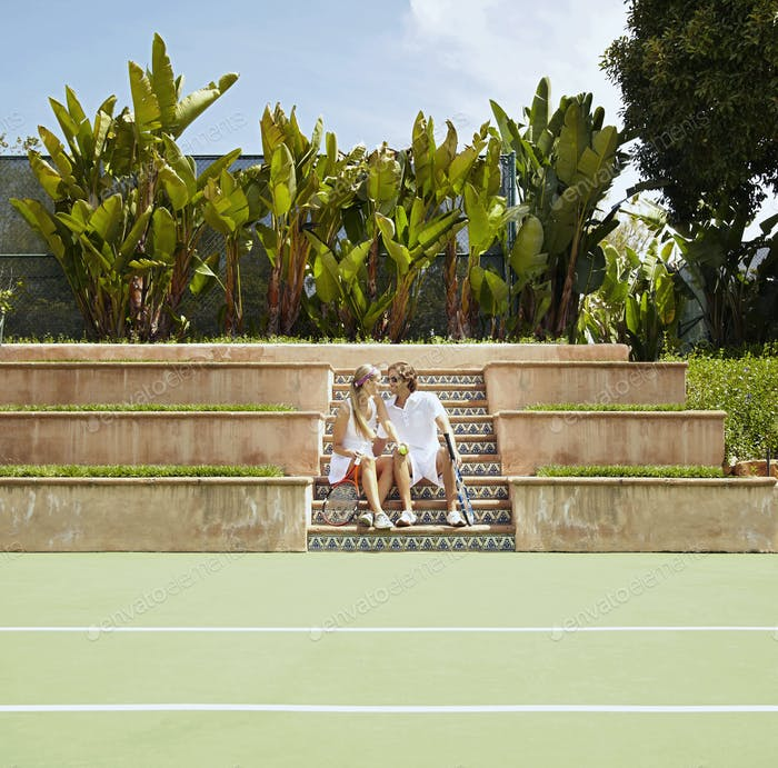 Caucasian couple playing tennis