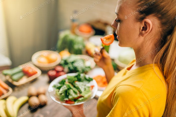 Young woman eating healthy eco food