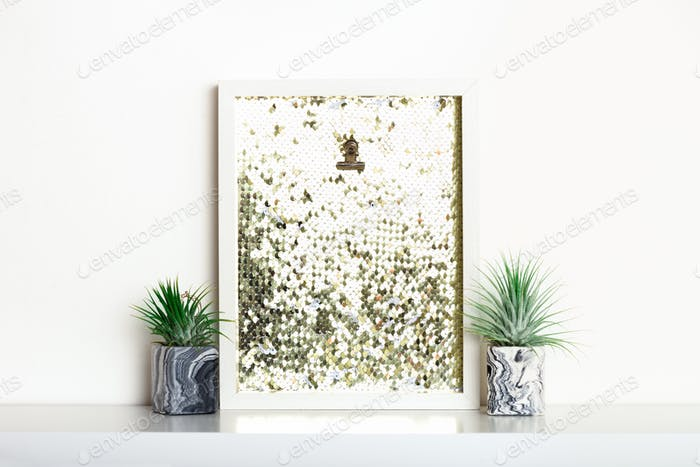 Lifestyle home decoration with frame with place for text and succulents