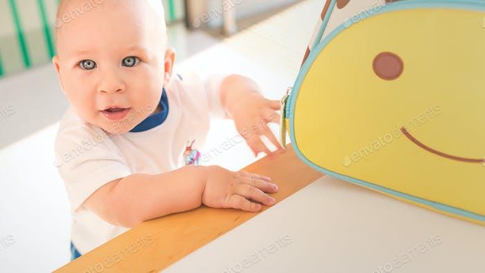 Little boy at colorful bag