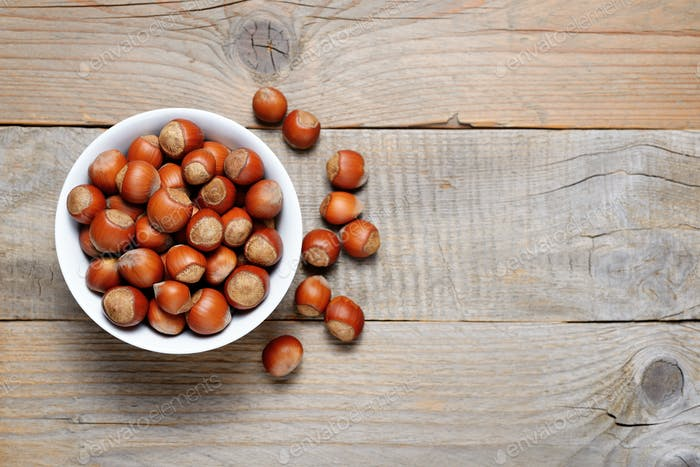 Hazelnuts on wooden table top view