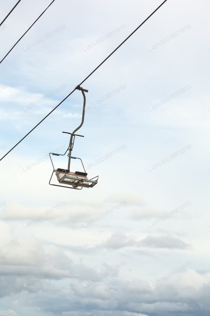 Empty chairlift with blue sky in the background