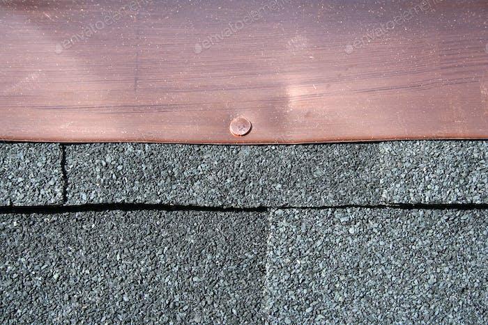 Black asphalt roofing shingles with copper flashing