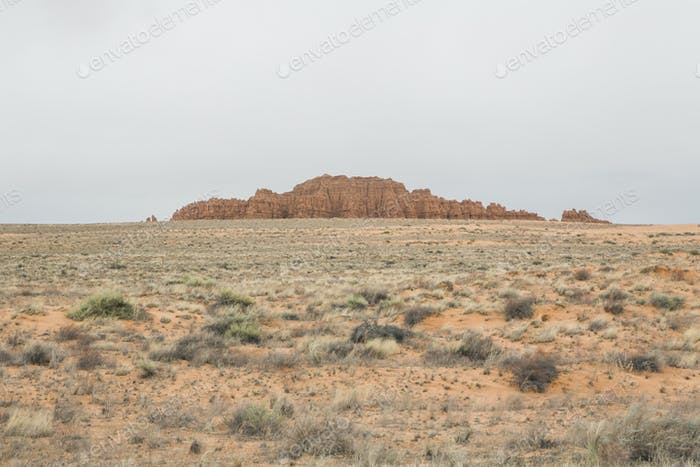 The barren desert and rock formations of Goblin Valley State Park in Utah.