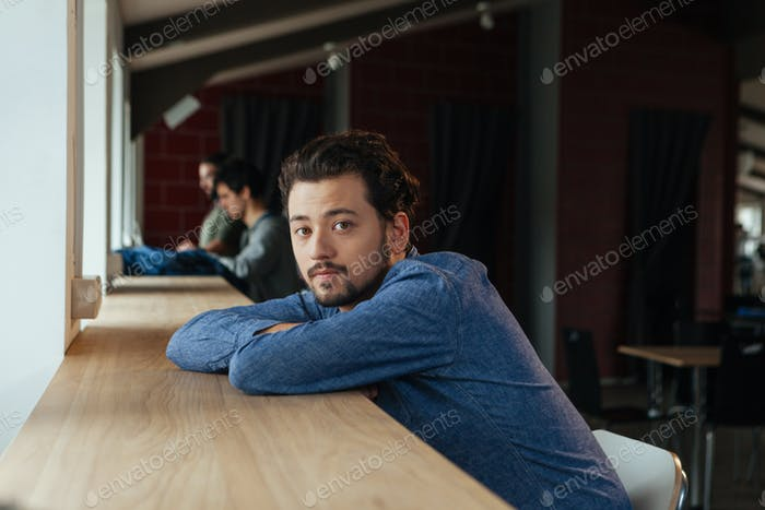 Man sitting at the table in office