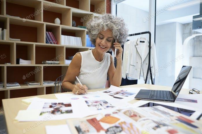 Senior female media creative working on the phone