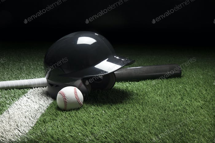 Baseball Helmet with Gray Bat on Green Field and Dark Background