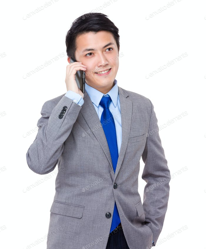 Asian Business man talk to mobile phone