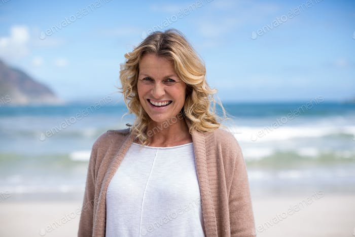 Portrait of mature woman standing on the beach