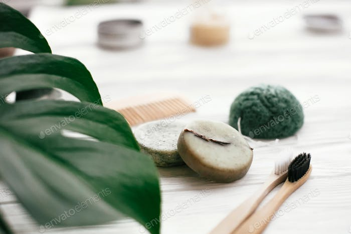 Eco friendly natural bamboo toothbrushes, shampoo bar, toothpaste in glass