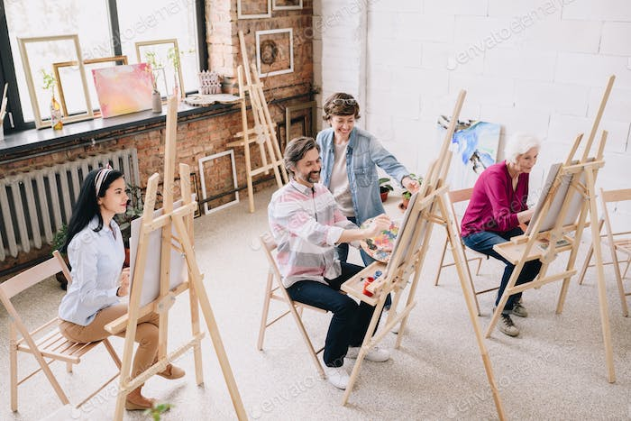 Students Painting at Easels in Art Studio