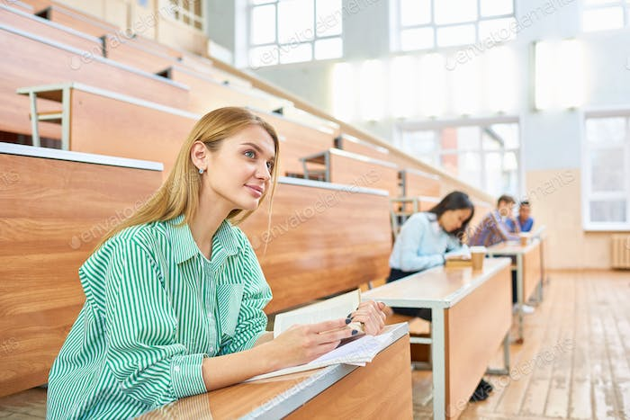 Group of Students at Desks in College