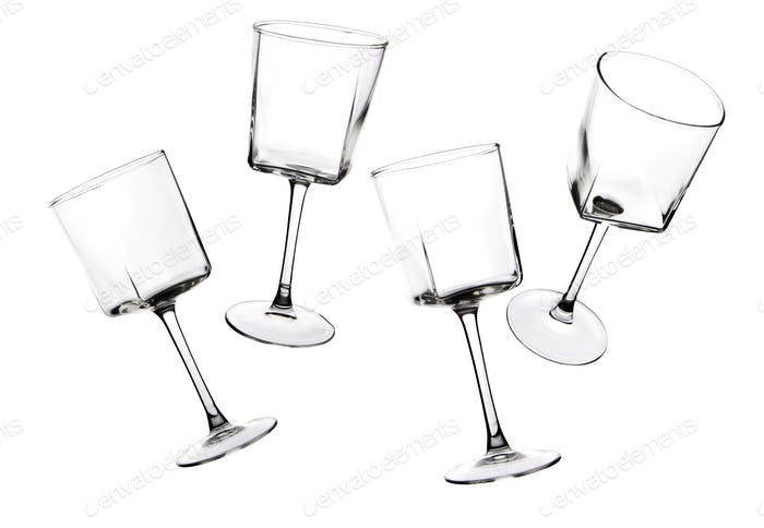 Silhouettes of stemware glass on a white background.