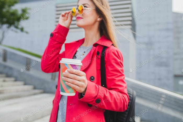 young hipster woman in pink coat