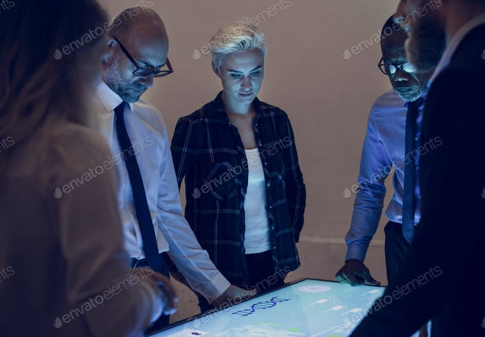 People in a technology meeting with cyber space table