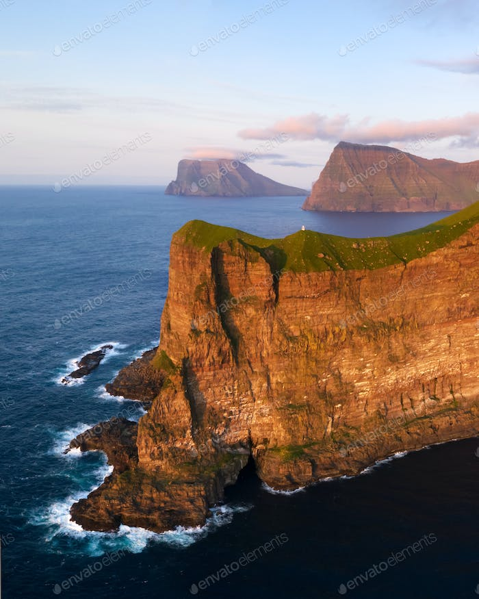 Kallur lighthouse on green hills of Kalsoy island