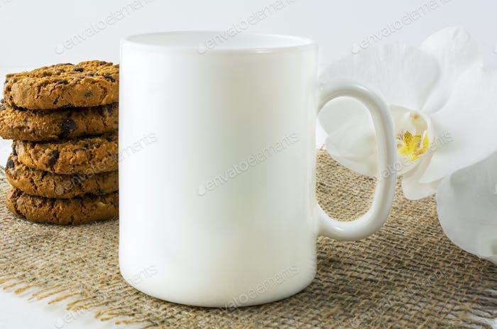 Coffee mug mockup with chocolates cookies