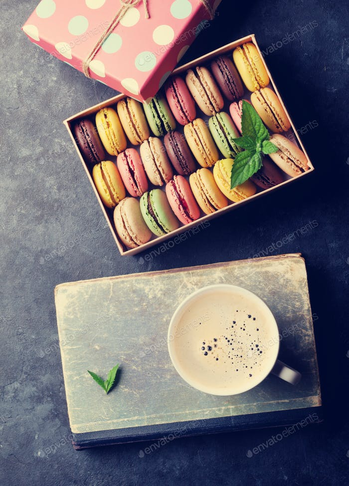 Colorful macaroons and coffee