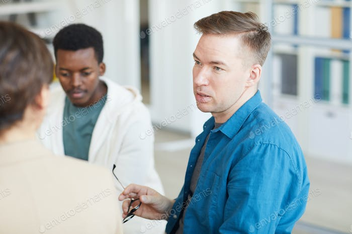 Male Psychologist Leading Support Group