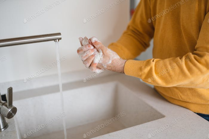 Washing hands with antibacterial gel man for corona virus prevention, hygiene