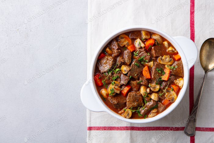 Beef Bourguignon Stew with Vegetables. Grey Background. Copy space. Top view.