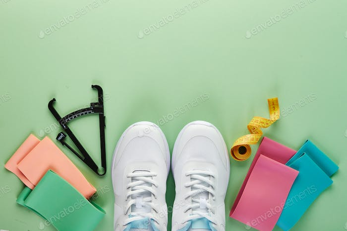 Creative flat lay of sport and fitness equipments.