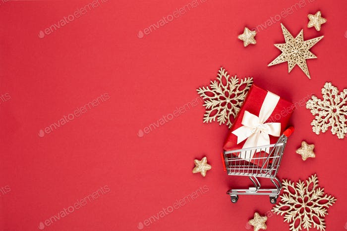 Christmas holiday present box on red background.