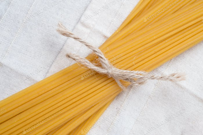 Tied pasta on the white tablecloth