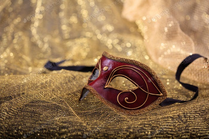 Carnival mask isolated on golden blur background