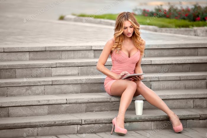 Sitting on stairs.