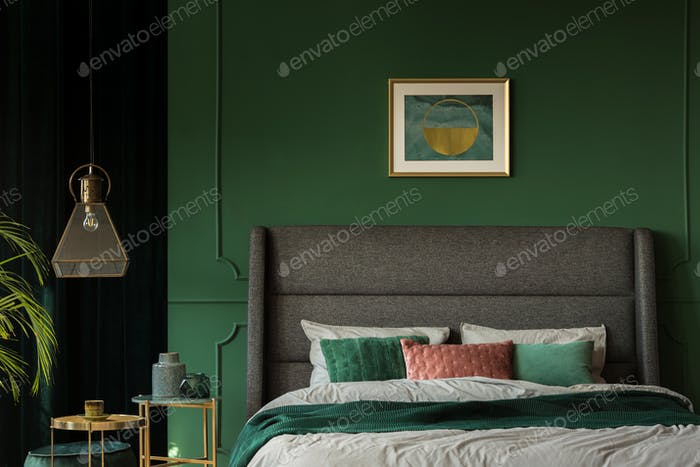 Stylish poster above comfortable king size bed with headboard in