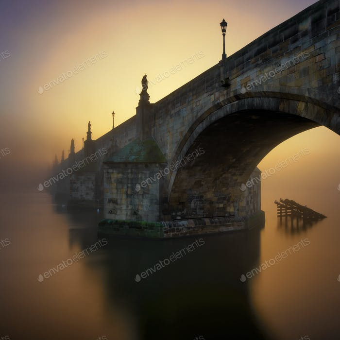 Charles bridge at foggy morning