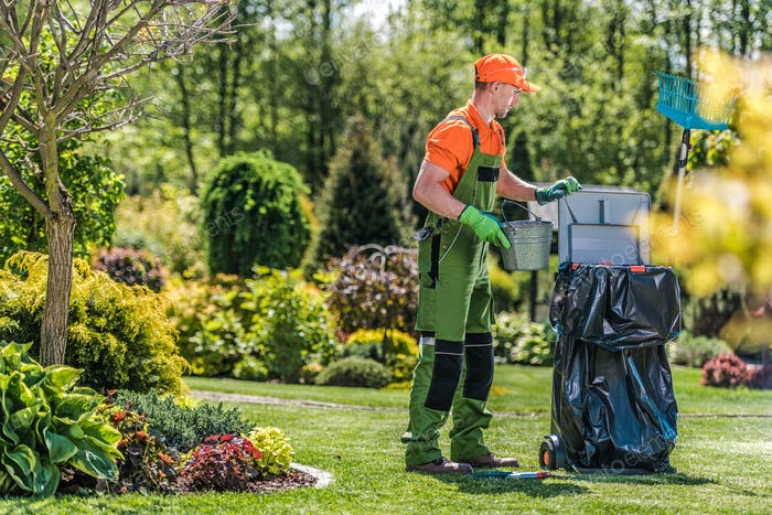 Gardener Cleans Private Yard Area After Routine Maintenance.