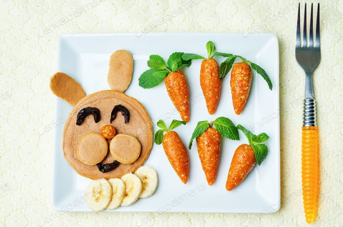 Pancake in the form of a rabbit and dried apricots cashew carrot