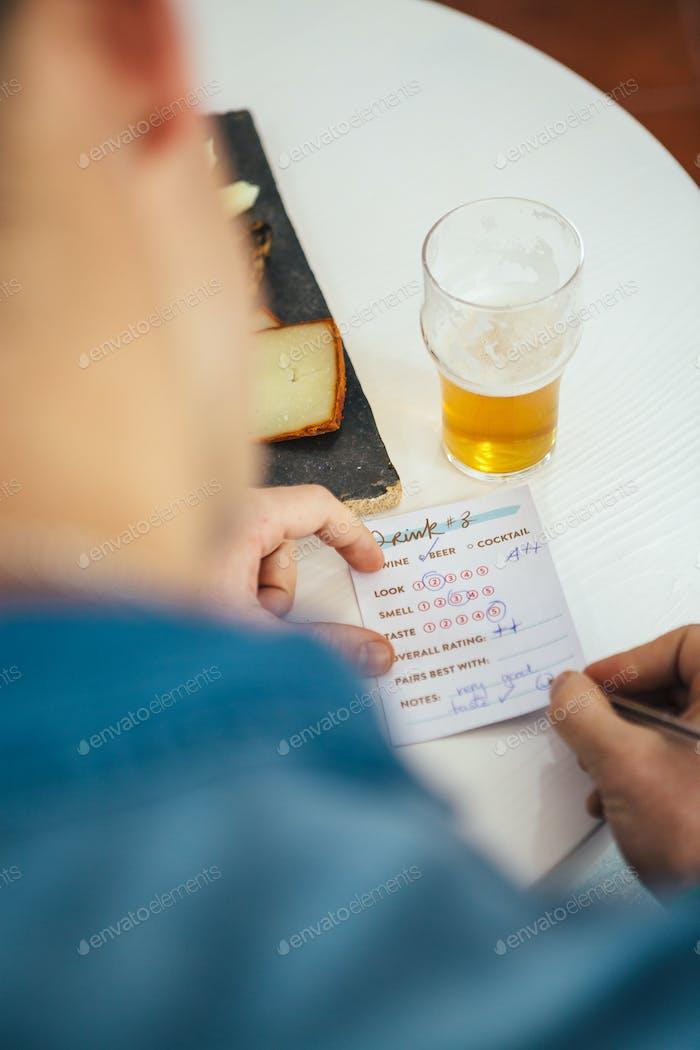 Man rating beer on list