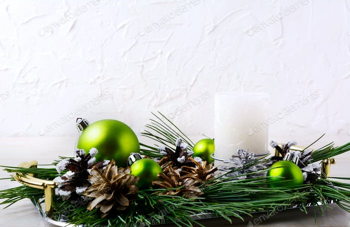 Christmas background with holiday ornaments and candle centerpie