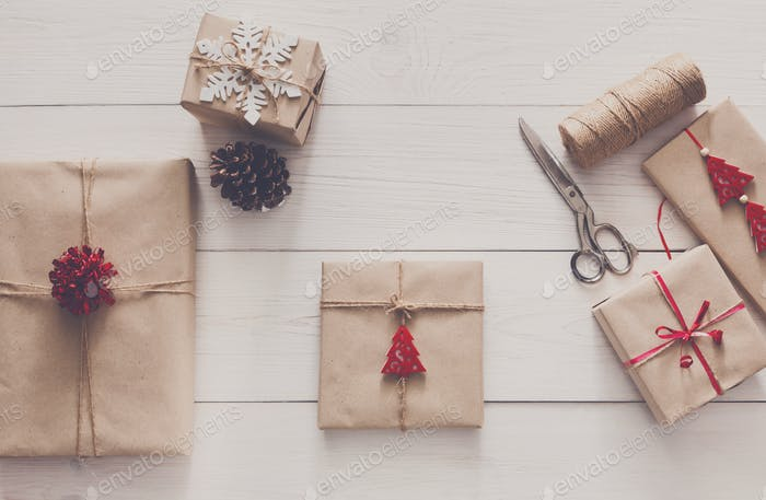 Wrapping christmas holiday present with craft twine