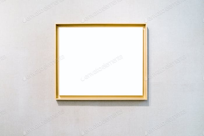 blank wooden picture frame on exhibition wall with clipping path