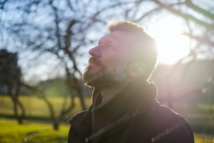 Portrait of an elderly man in a park.