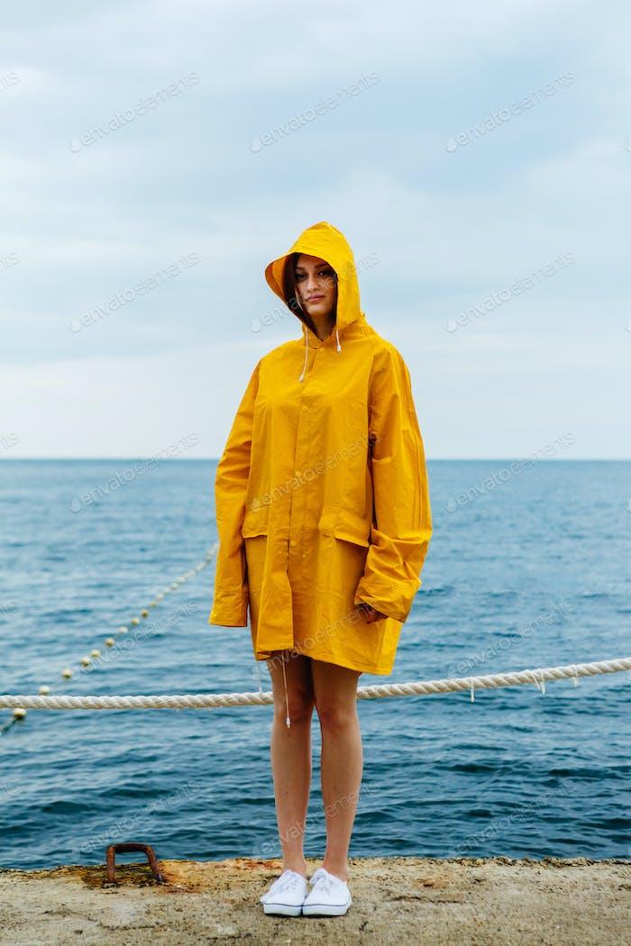 Girl wearing yellow raincoat