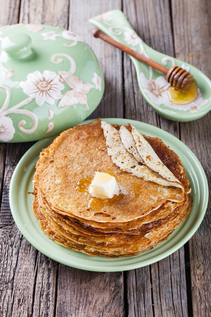 Pancakes with butter and honey.