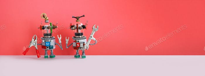 Two repairman locksmith robots with hand wrench pliers on pink wall background.