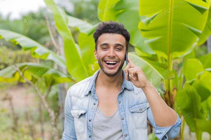 Young Hispanic Man Talking Phone Call Tropical Forest Hotel Terrace Holiday Guy Summer Vacation