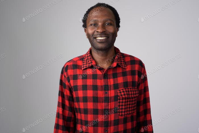 Portrait of happy African hipster man smiling