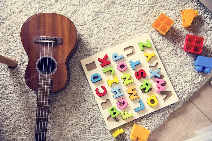 Guitar and educational toys in living room