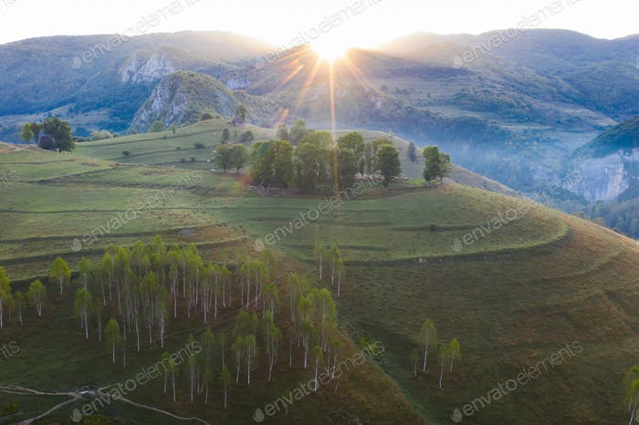 Drone view of beautiful summer sunrise over Transylvanian mountains.