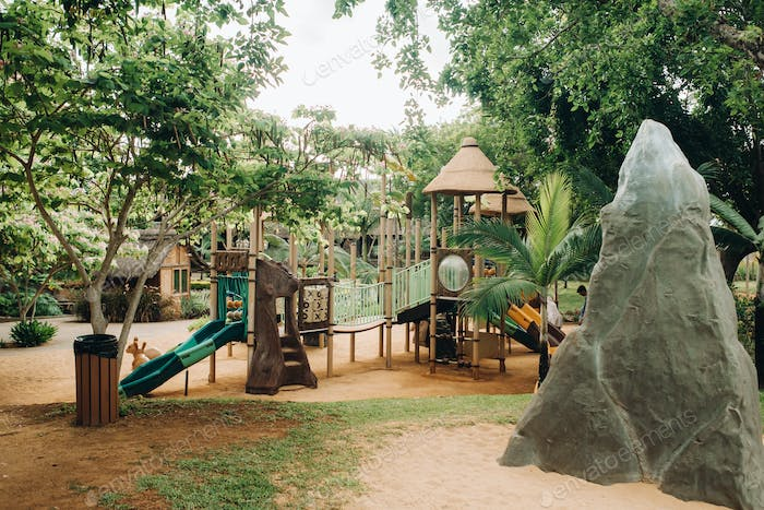 A public Playground in a Park on the island of Mauritius. Colorful Playground in the Park. A Park