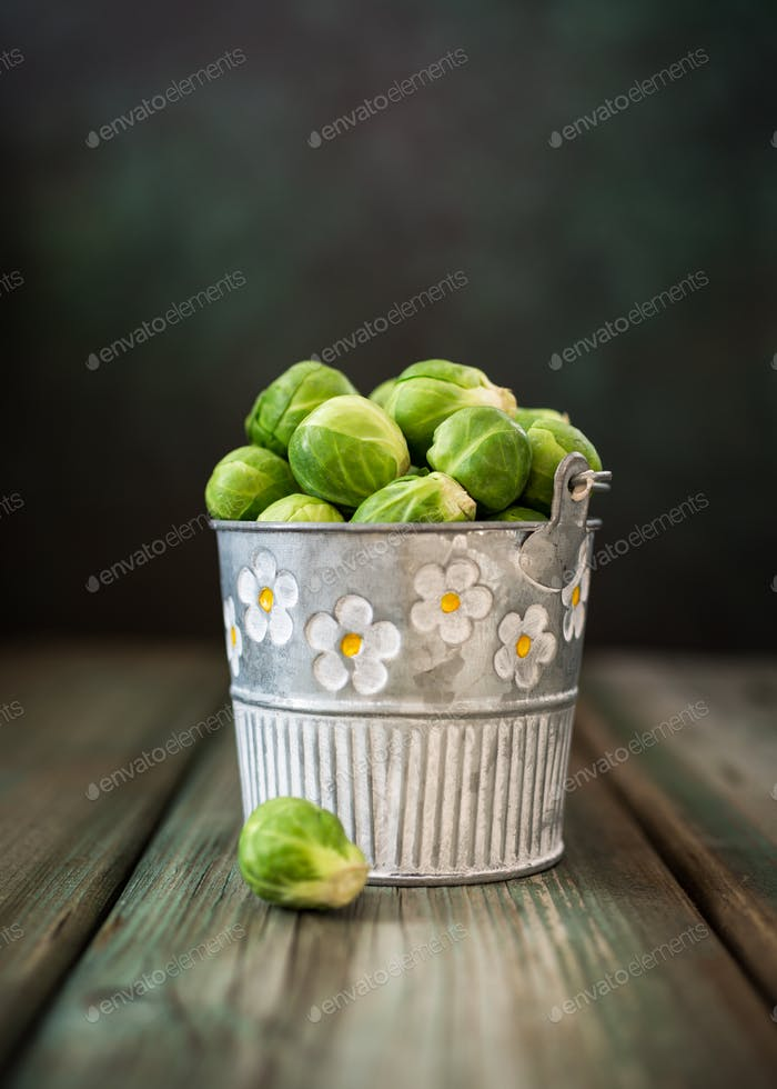 Fresh Brussels sprouts in metal bucket