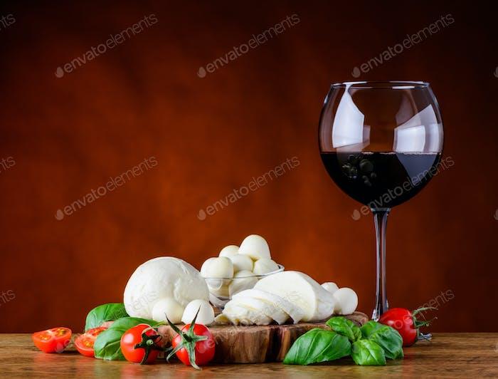 Glass Red Wine and Mozzarella Cheese