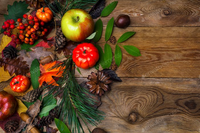 Fall greeting with acorn on wooden table
